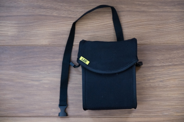 Lee Filters Field Pouch in black with the tripod strap attached.