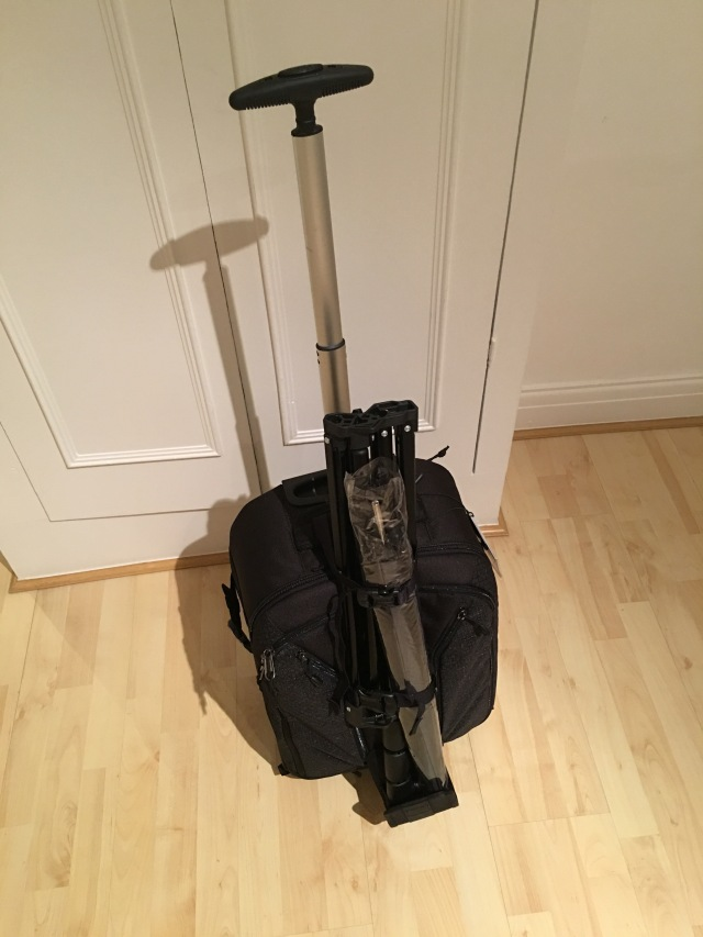 Light stand and umbrella attached using the very convenient tripod pocket and straps.