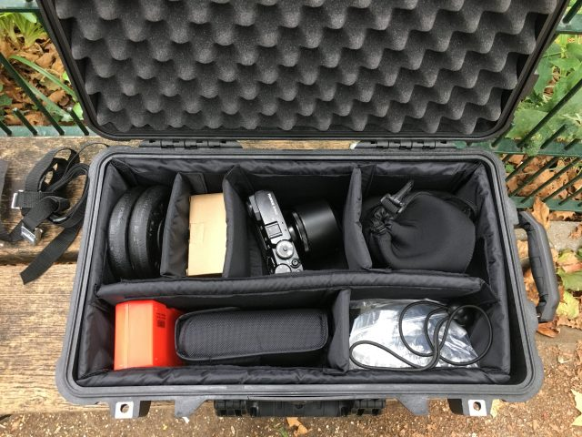 On location for a portrait shoot and camera, flash, modifiers and light stand fit either inside or strapped to the bag.